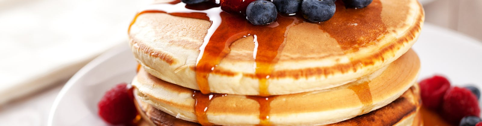 Pancake stack with fruit and syrup