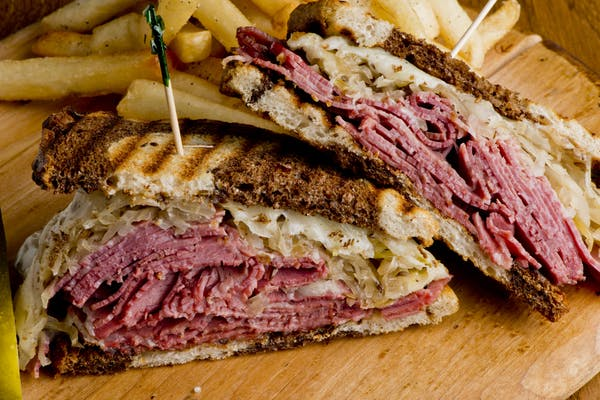 Pastrami Reuben sandwich with fries