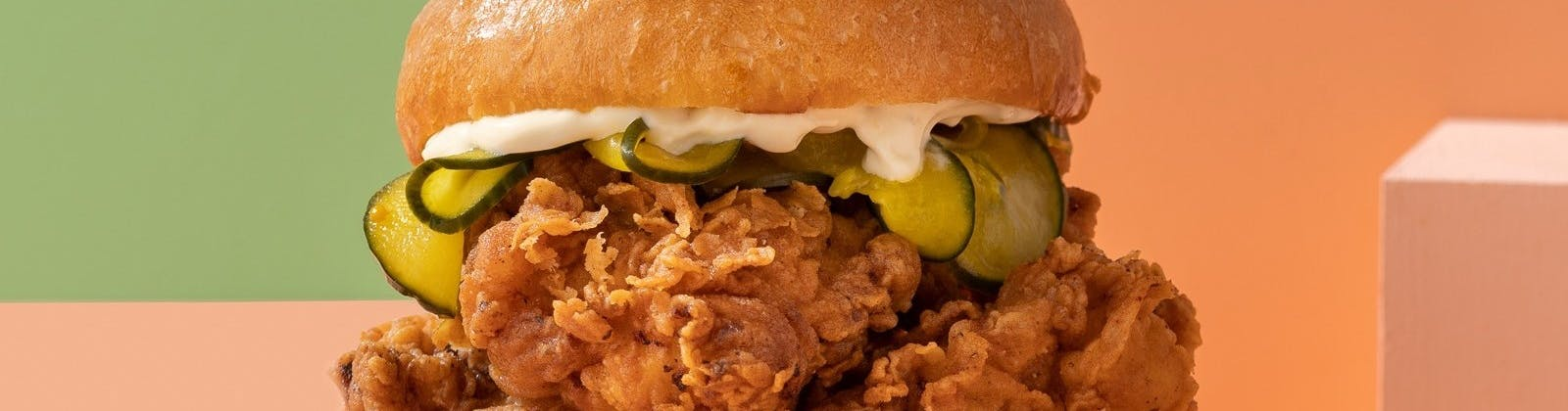 chicken burger with pickles and mayo from peach's hot chicken