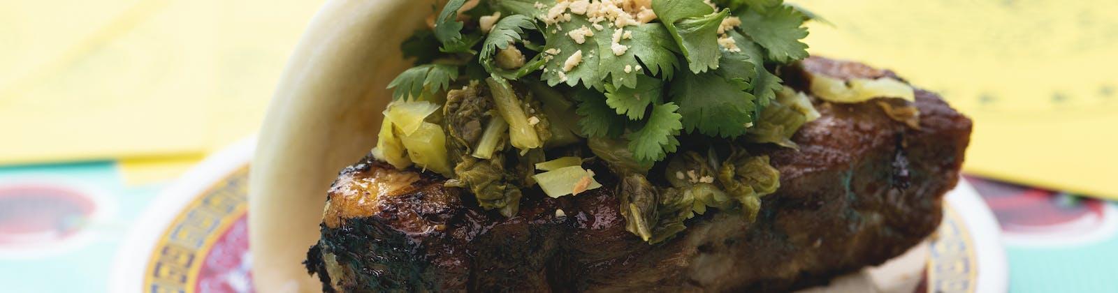 braised pork leg in a bao bun with coriander