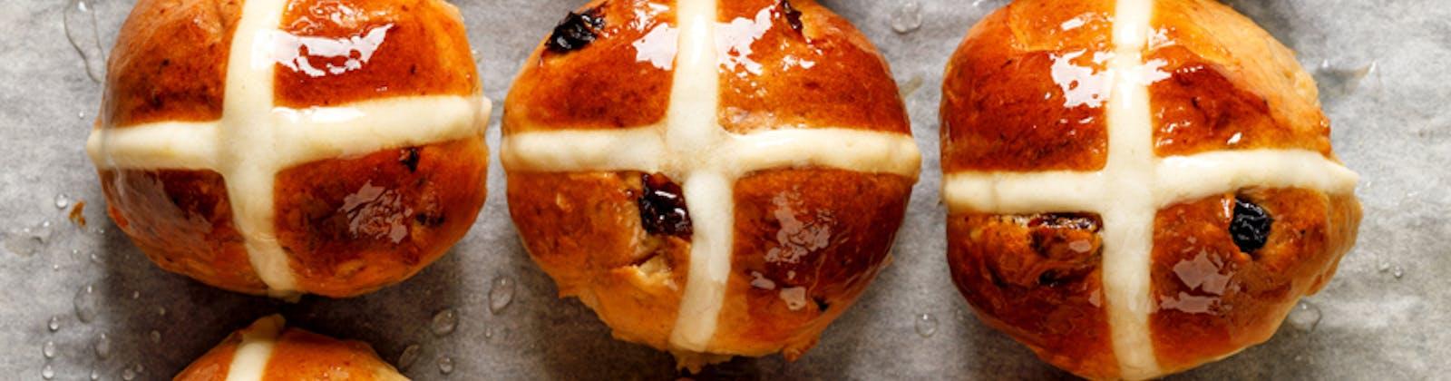 hot cross buns glazed on a tray