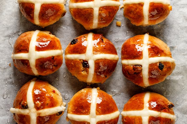hot cross buns glazed on a tray