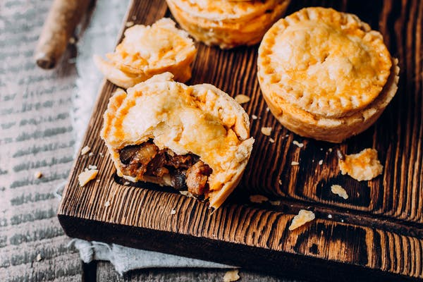 Pies on wooden board