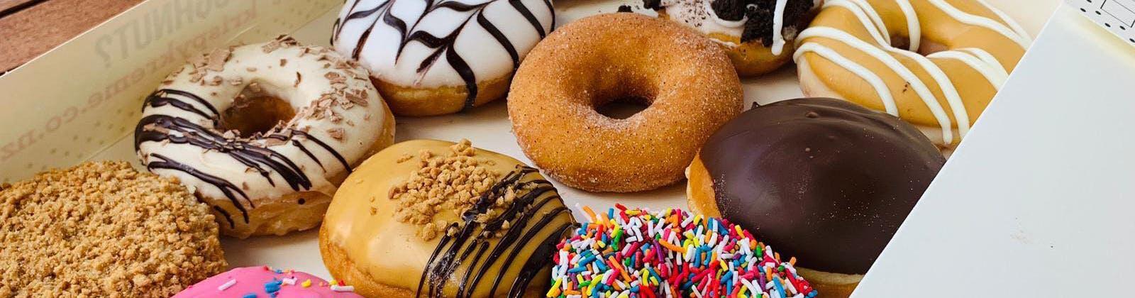 Assorted dozen doughnuts from Krispy Kreme