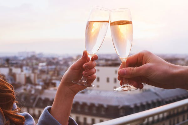 Couples cheers-ing Champagne flutes
