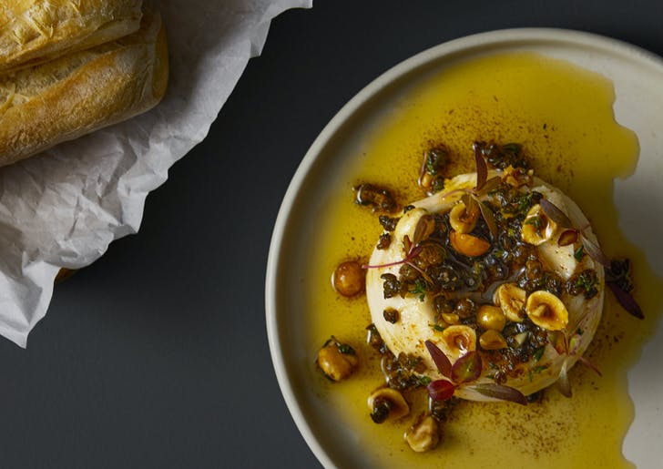 Whipped 'haricot blanc' beans with preserved lemon and caper butter.