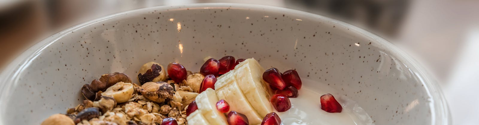 Granola bowl with pomegranate and banana