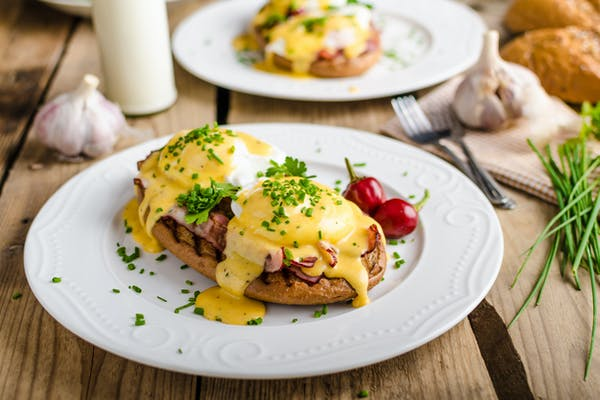 Eggs Benedict on wooden table