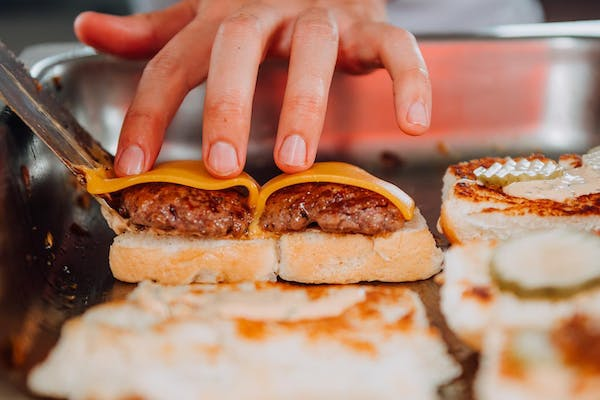 burgers having cheese melted over them