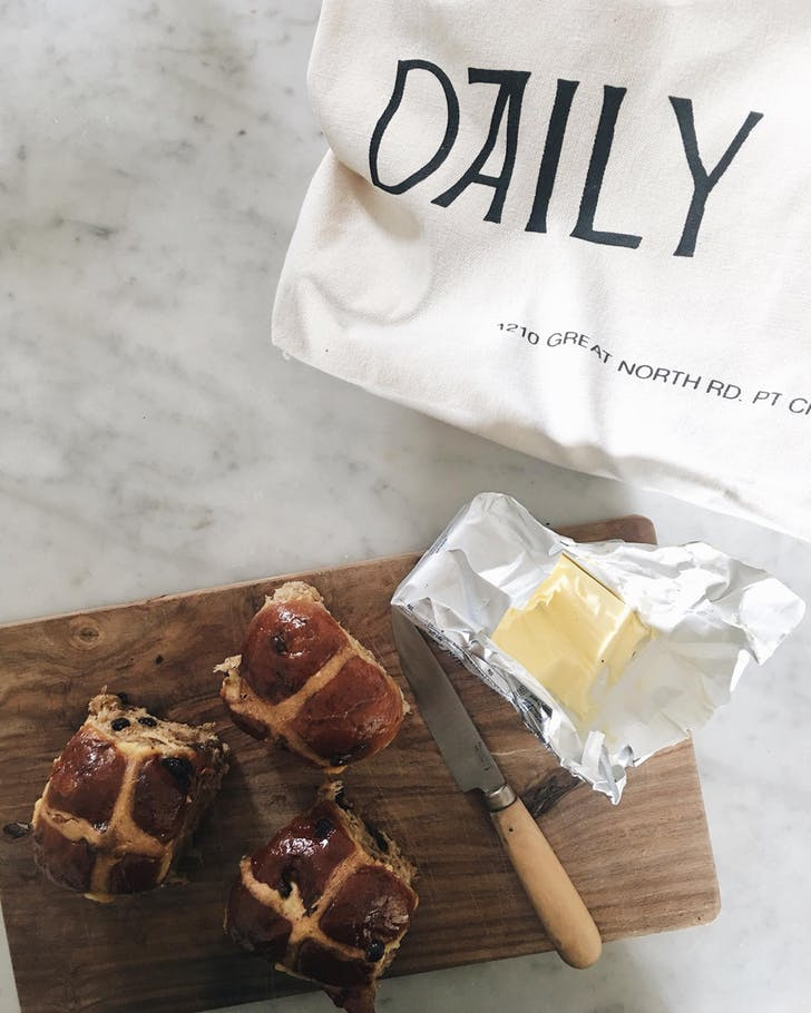 Daily Bread's Hot Cross Buns served hot with butter.