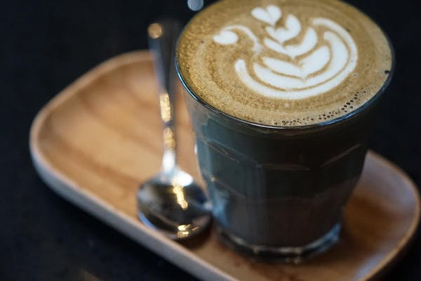 vibe coffee roasters charcoal latte