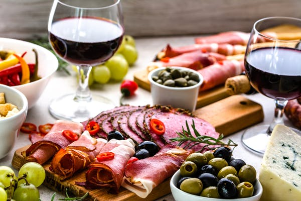 Greek platter with cheese meat and red wine