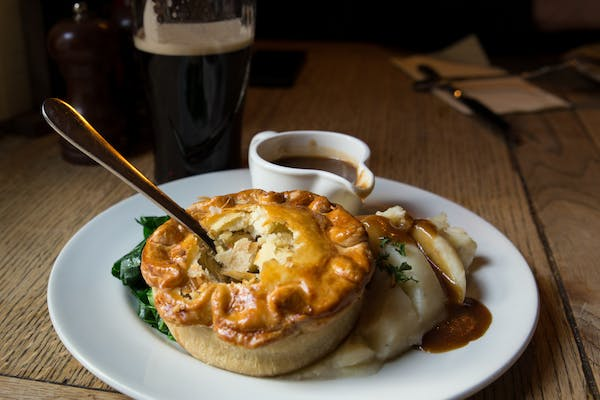 Pub pie with potato mash and greens