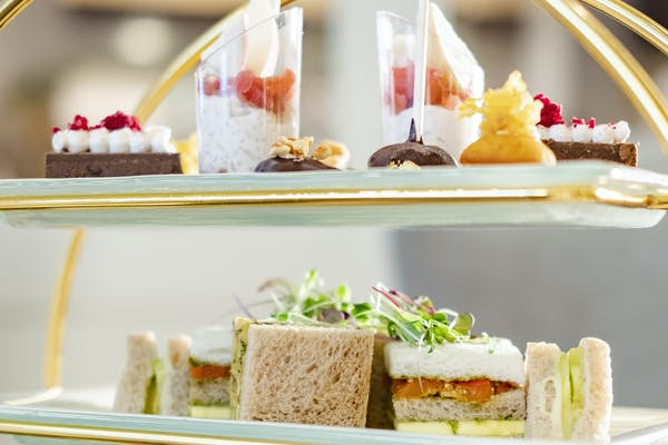 vegan sandwiches, cakes, and desserts in a high tea