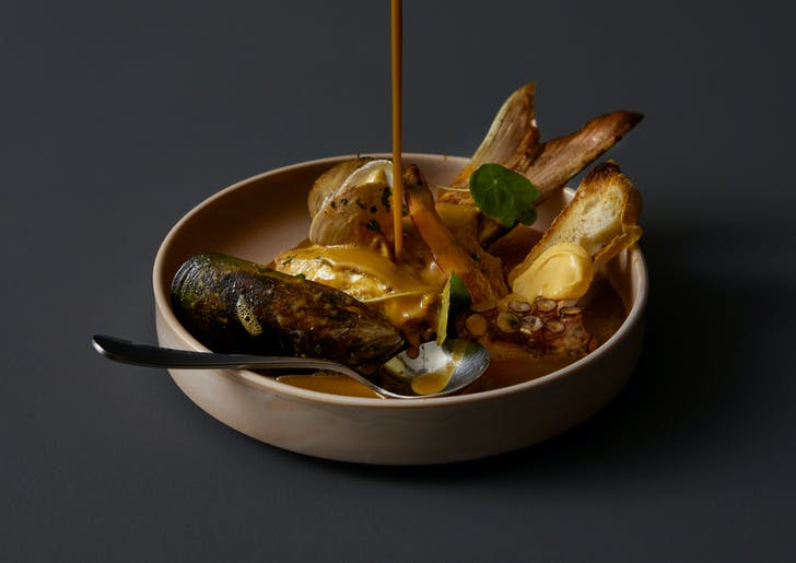 Bouillabaisse with line caught fish 'on the bone', mussels, clams, local octopus, and saffron rouille.