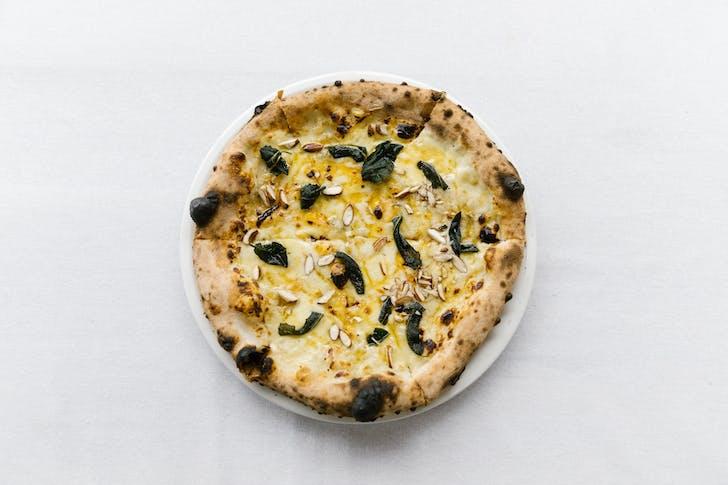 Elmo's truffle 4-cheese pizza returns.