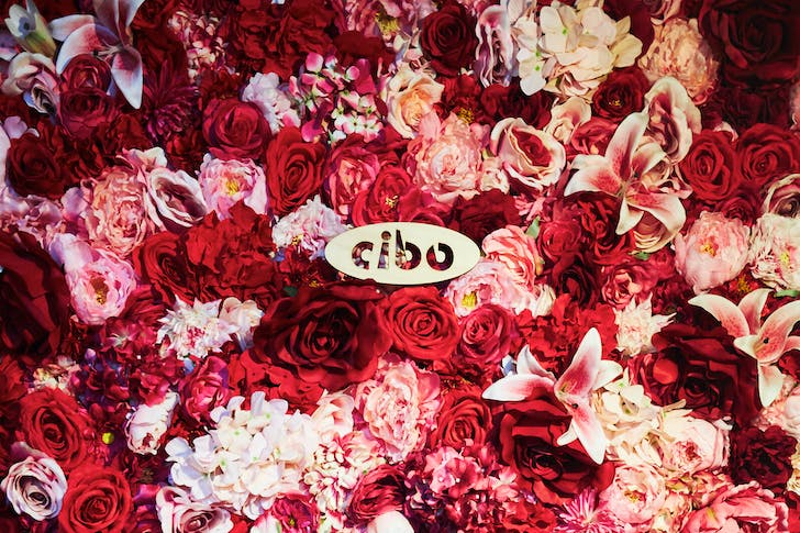Romantic touches at Cibo with their welcoming flower wall