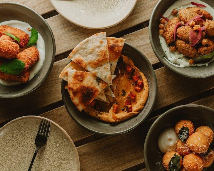 House-made Roasted Kumara Hummus and Flatbread.
