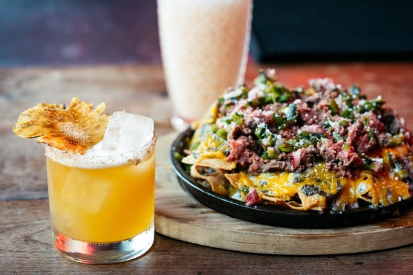 margarita and nachos at ghost donkey commercial bay