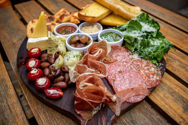 Union post platter with meats, cheese, salad, garlic bread, and olives