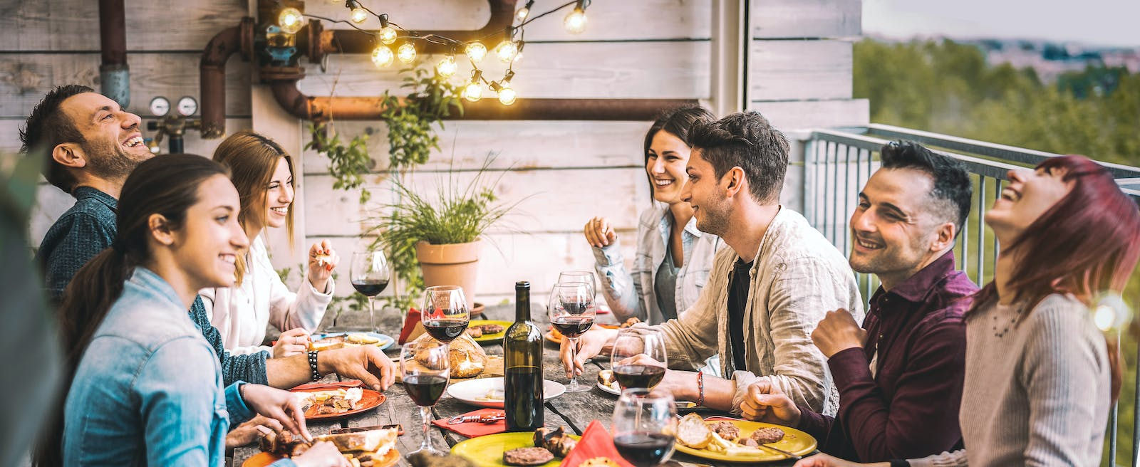 People eating at a table with wine