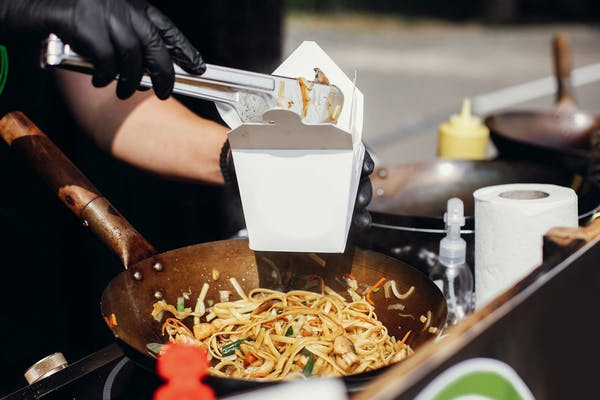 noodles being served at a street festival