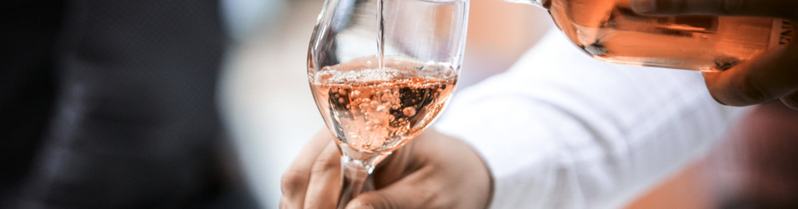 Rosé wine being poured in glass
