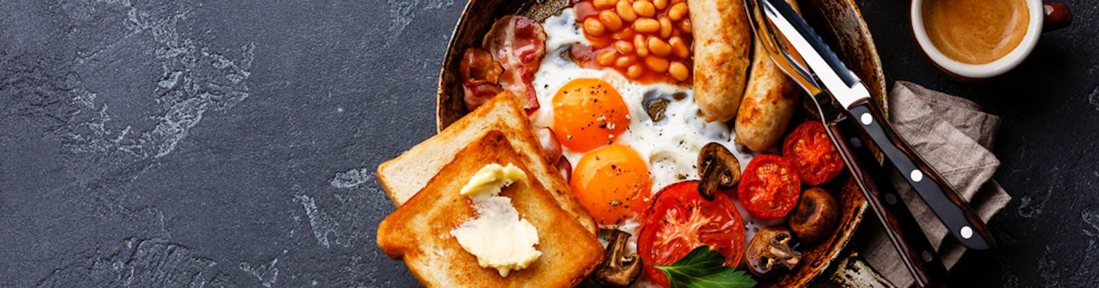 Big breakfast in a cast iron pan