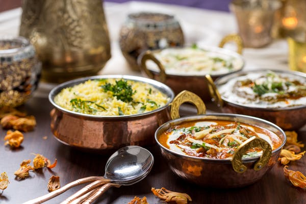 Indian restaurant dishes being served