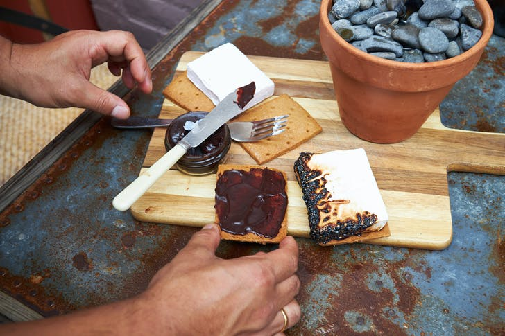 Step 1: Slather your graham crackers in chocolate ganache.