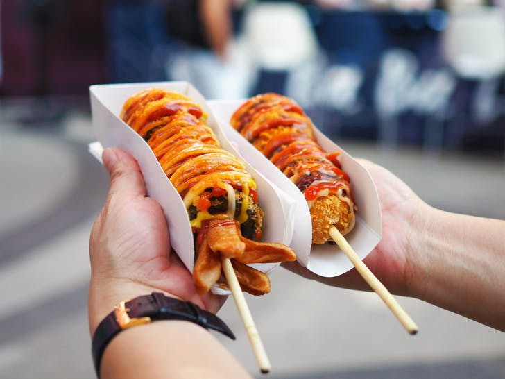 Korean Hot Dogs covered in batter, sugar, and sauces.