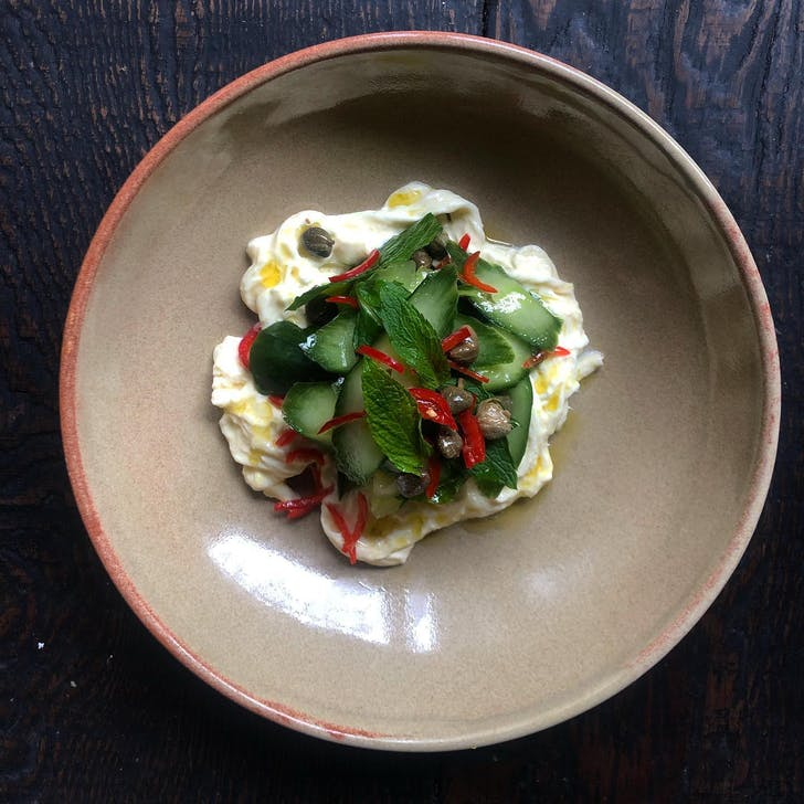 Stracciatella with salted cucumber, chilli, capers, mint, and lemon from Cotto