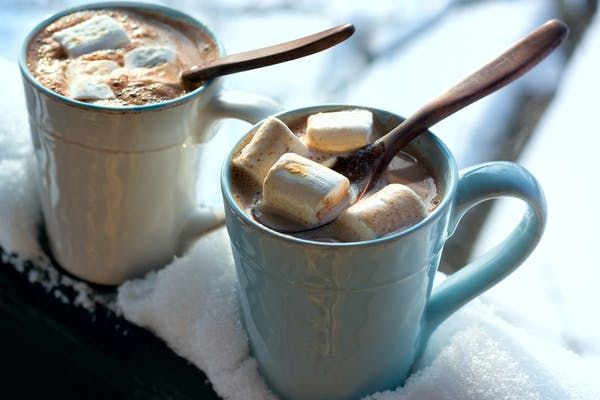hot chocolates in mugs with marshmallows