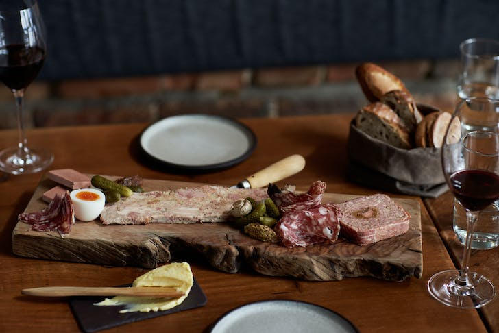 Apero's charcuterie board served with a fresh baguette