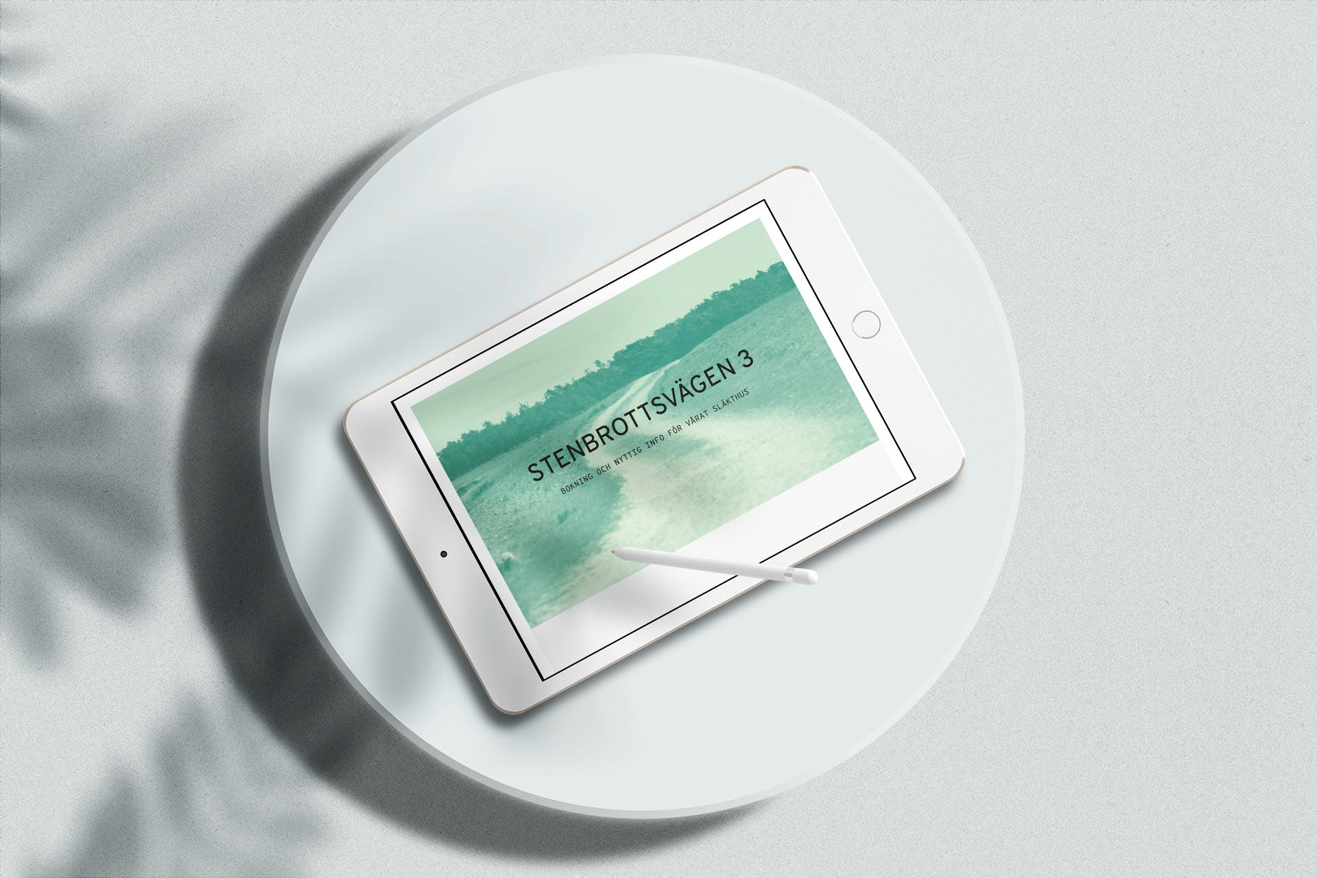 Close up of an white iPad showing the main view of the Stenbrottsvägen website