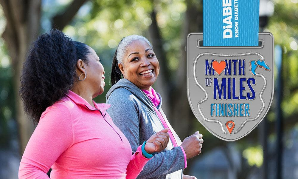 Two ladies smiling as they take part in Diabetes UK's Month of Miles challenge alongside an image of fundraising reward medal.