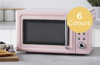 pink microwave sat on counter