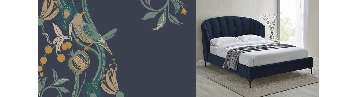 navy upholstered bed in a neutral room