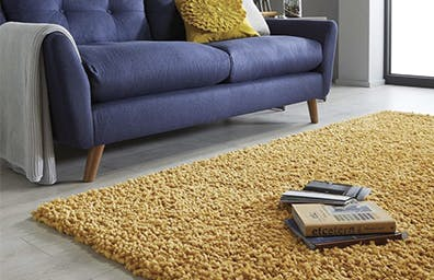 5 WAYS TO STYLE A PLAIN RUG