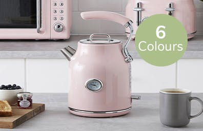 bundle of pink microwave, kettle and toaster on counter
