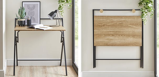 Split image to show the oak effect desk both up with a notebook and lamp on and then folded and hanging on the wall