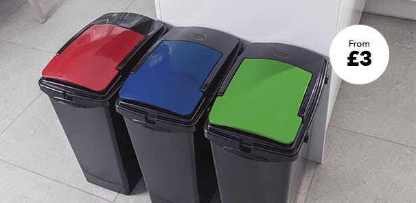 3 recycling bins lined up in kitchen with multicolour lids