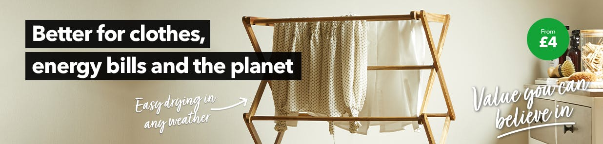 Wooden 3 tier airer in utility room with clothes on