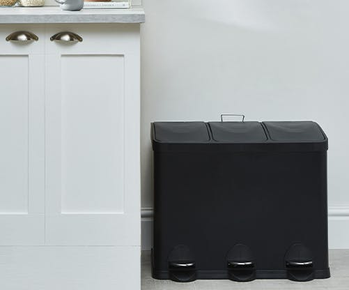 black bin with 3 sections in a white kitchen