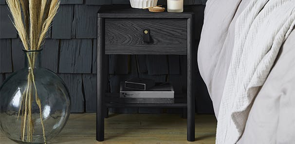 Black Oak effect bedside table with a PU leather handle