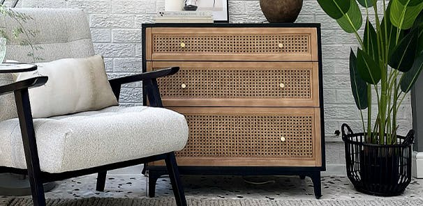 Warm-toned natural rattan panels soften up the look