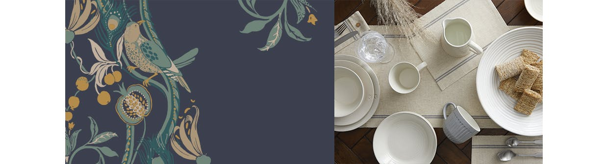 Dining table dressed with plates, mugs, glasses and a table runner