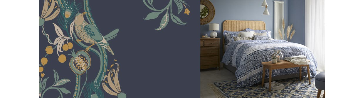 global designed bedding on a textured wooden bed in a blue bedroom