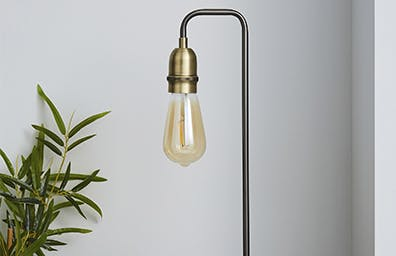 Industrial style table lamp against a grey wall background