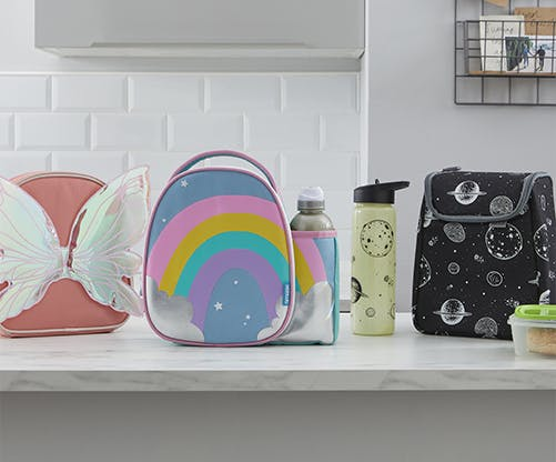 A collection of lunch boxes and water bottles on a kitchen worktop